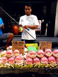 Asian street vendor selling pomelo fruit in a market in quiapo, manila, philippines in asia Royalty Free Stock Image
