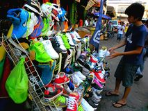 Asian street vendor selling rubber shoes in quiapo, manila, philippines in asia Royalty Free Stock Images