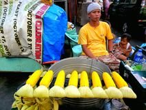 Asian street vendor selling steamed corn on a cob in quiapo, manila, philippines in asia Stock Image