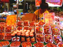 Asian street vendor selling strawberries in quiapo, manila, philippines in asia Stock Photos