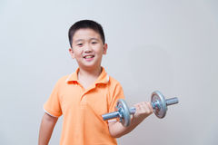 Asian strong boy lifting weights, Stock Photography