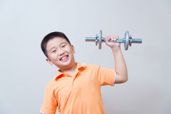 Asian strong boy lifting weights, Stock Photo