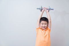 Asian strong boy lifting weights, Royalty Free Stock Images