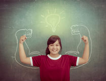Asian strong children against blackboard in classroom, Education Stock Photography