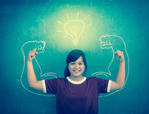 Asian strong children against blackboard in classroom, Education Royalty Free Stock Photography