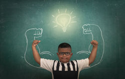 Asian strong children against blackboard in classroom, Education concept Stock Image