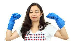 Asian strong girl posing with cleaning glove and apron on white Royalty Free Stock Photography