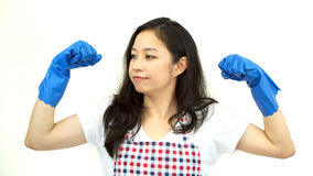 Asian strong maid woman wearing cleaning glove and apron Royalty Free Stock Images