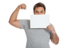 Asian strong man  flexing biceps  close his mouth with a blank s Royalty Free Stock Photography