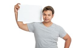 Asian strong man  flexing biceps show blank sign on his shoulder Royalty Free Stock Photos