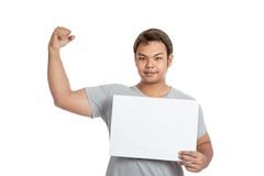 Asian strong man  flexing biceps show blank sign look at the cam Stock Photography