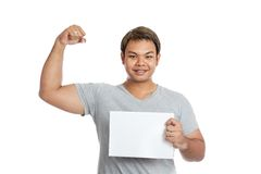 Asian strong man  flexing biceps show blank sign and smile Stock Photography