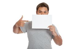 Asian strong man point to a blank sign Stock Images