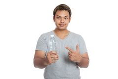 Asian strong man point to a bottle of water and smile Royalty Free Stock Photography