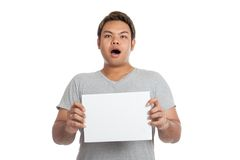 Asian strong man  shocked, surprised, with  blank sign Royalty Free Stock Images
