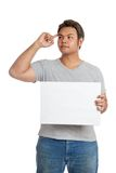 Asian strong man show  a blank sign think of something. Isolated on white background Stock Image