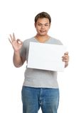 Asian strong man show OK sign with a blank sign and smile Royalty Free Stock Photography