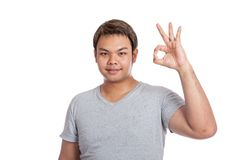 Asian strong man show ok sign look at the camera Stock Photography
