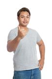 Asian strong man show thumbs-up and smile Royalty Free Stock Image