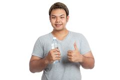 Asian strong man thumbs-up with a bottle of water and smile Royalty Free Stock Photography