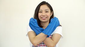 Asian strong woman wearing cleaning glove and apron Stock Photos