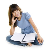 Asian student. Sitting on floor, blank book ready for text Stock Photo