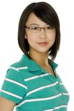 Asian Student. An attractive asian young woman in spectacles on white background stock photography