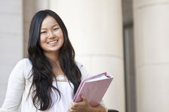 Asian Student. An attractive Asian college student portrait outside of a school building Stock Photo