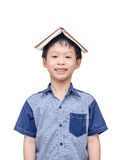Asian student  with a book on his head Stock Image