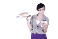 Asian student with books and digital tablet Royalty Free Stock Image