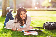 Asian student on campus. A shot of an asian student studying on campus lawn Royalty Free Stock Photo