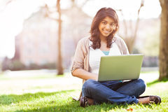 Asian student on campus Royalty Free Stock Photos