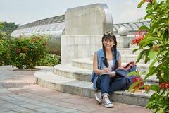 Asian Student Doing Homework Outdoors Royalty Free Stock Photos