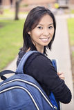Asian student girl on campus. Asian student girl on university college campus smiling Royalty Free Stock Photos