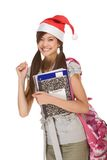 Asian student girl in Christmas Santa hat Royalty Free Stock Photos