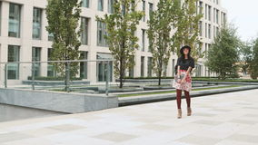 Asian student girl walking in city stock footage