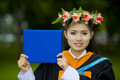Asian student on her graduation day. Proud asian student showing on her graduation day Stock Images