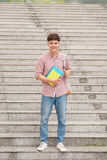 Asian student with his books  and wearing backpack. Asian student with his books and wearing backpack Stock Photos
