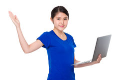 Asian student hold with laptop computer and open hand palm Stock Photos
