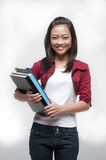 Asian Student holding books Royalty Free Stock Images