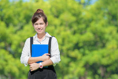 Asian student holding books on campus at college Royalty Free Stock Image