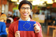 Asian student holding flag of europe union Stock Photography