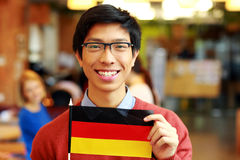 Asian student holding flag of germany Royalty Free Stock Image