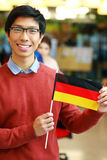 Asian student holding flag of germany Stock Photography