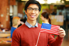 Asian student holding flag of USA Royalty Free Stock Photography
