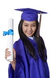 Asian student holding graduation degree Royalty Free Stock Photos