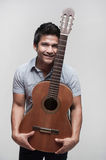 Asian Student holding a guitar Stock Images