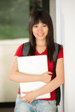 Asian student with laptop Royalty Free Stock Photography