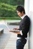 Asian student and laptop stock photos
