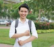 Asian student with laptop Stock Photography
